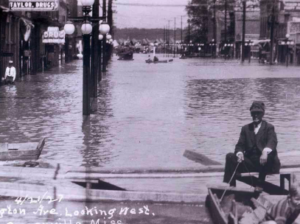 The great flood of 1927 left Greenville waterlogged for months. This photo was shot looking west on Washington Avenue. Courtesy of the Nelken Archives, Greenville, Miss.
