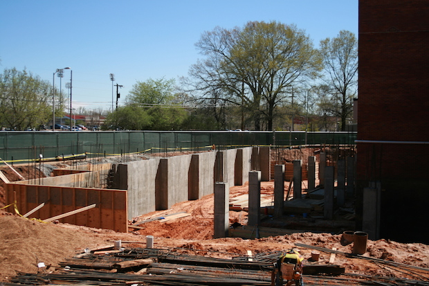 The addition at Coulter Hall is in the foundation stages, and isn't easily visible to students and passersby because of the green fencing that surrounds the project.