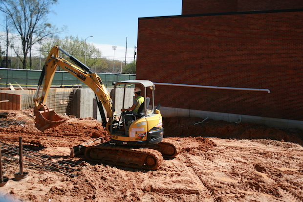 Workers are leveling up ground at Coulter Hall, where the university is construction an addition.
