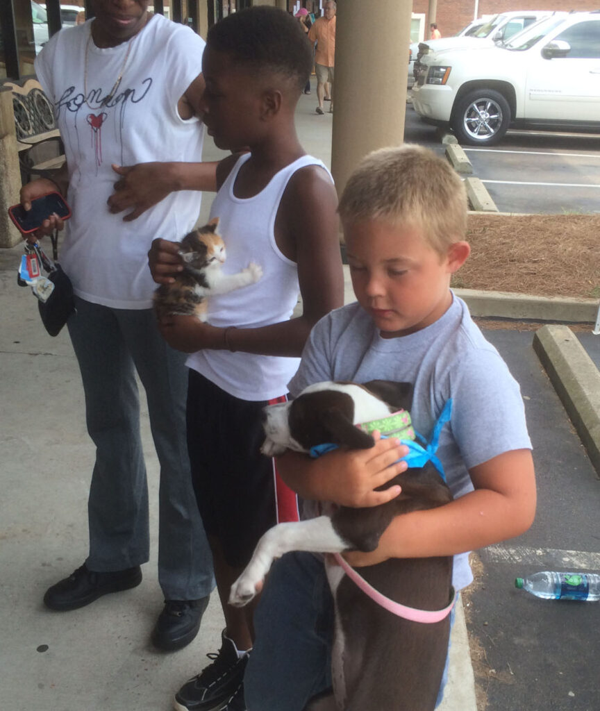 Oxonians love on OLHS animals at Hollywood Feed's Adoption Day.