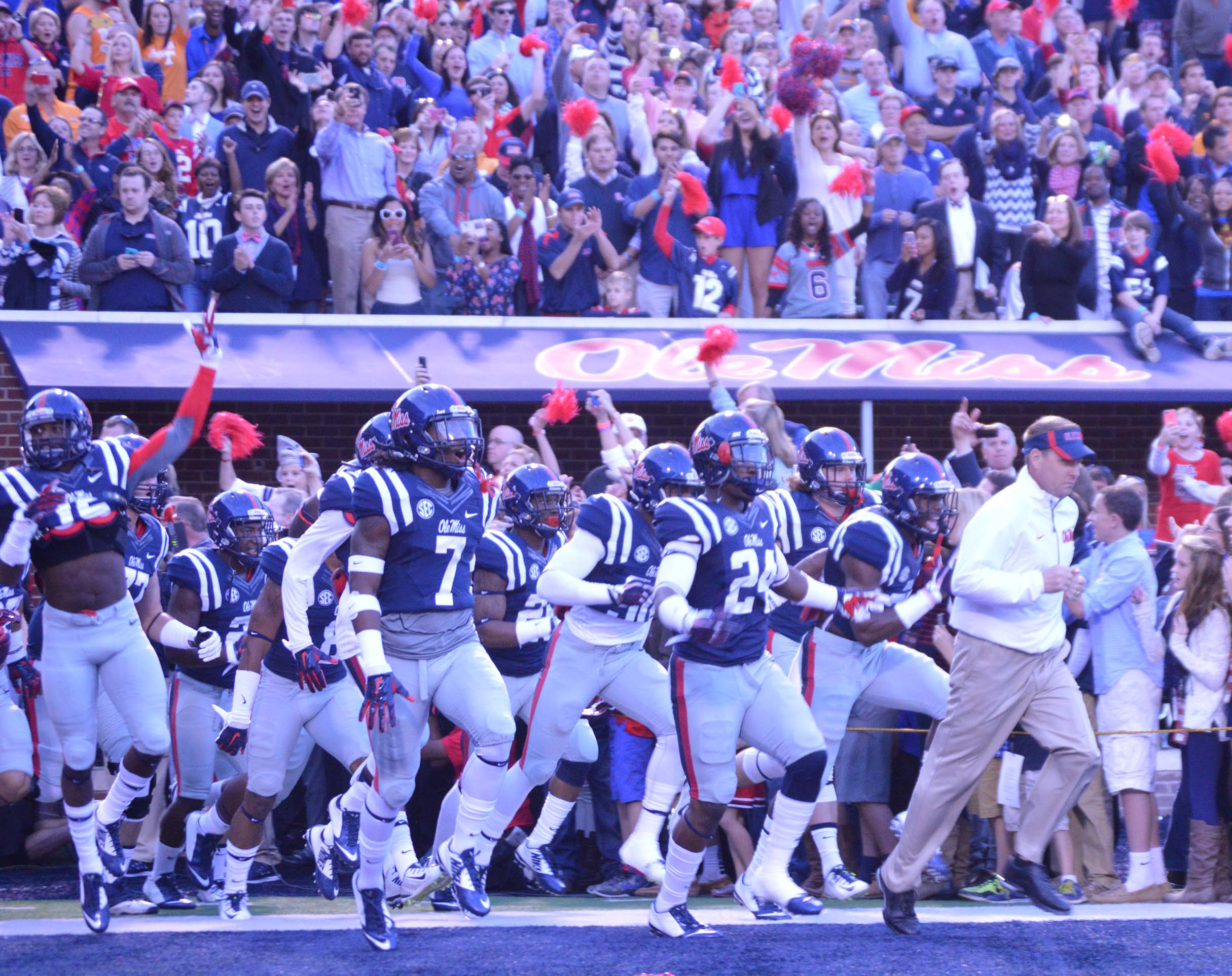 Coach Hugh Freeze leads the Rebels out of the tunnel before the Tennessee game. / Photo by Callie Daniels
