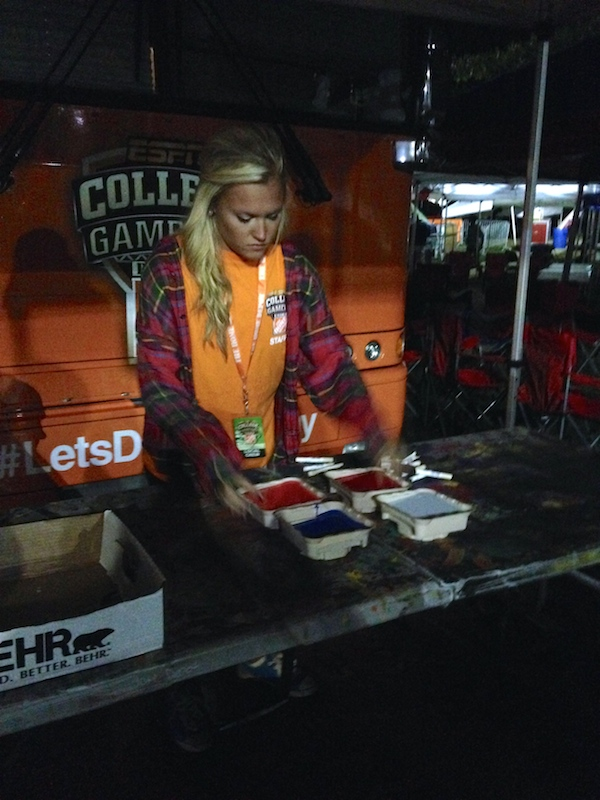 Chandler Marie Morgan painting signs for College GameDay bright and early