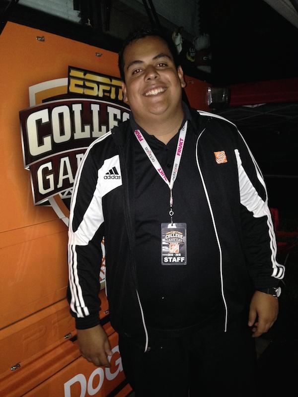 ESPN College Game Day staff/volunteer coordinator Alvaro Voelker poses in front of the GameDay Bus