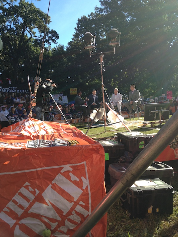 Behind-the-scenes shot of Desmond Howard, Chris Fowler, Lee Corso, and Kirk Herbstreit on the College GameDay side stage