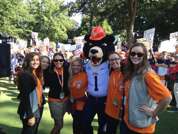 Student volunteers Sam Mitchell, Tessa Poyner, Ashley Dunn, Chandler Marie Morgan, Olivia Wells, and Catherine Carroon take a moment to pose with Rebel the Black Bear with his College GameDay hat