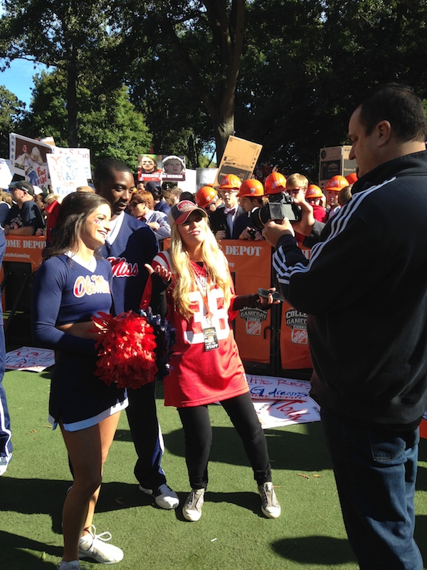 ESPN College GameDay's social media correspondent Deanna Kay stops to interview Ole Miss cheerleaders in preparation for her College GameDay Playback