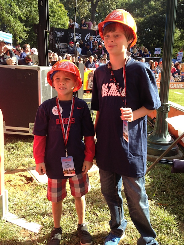 Two young Ole Miss fans sport their College GameDay hats behind-the-scenes
