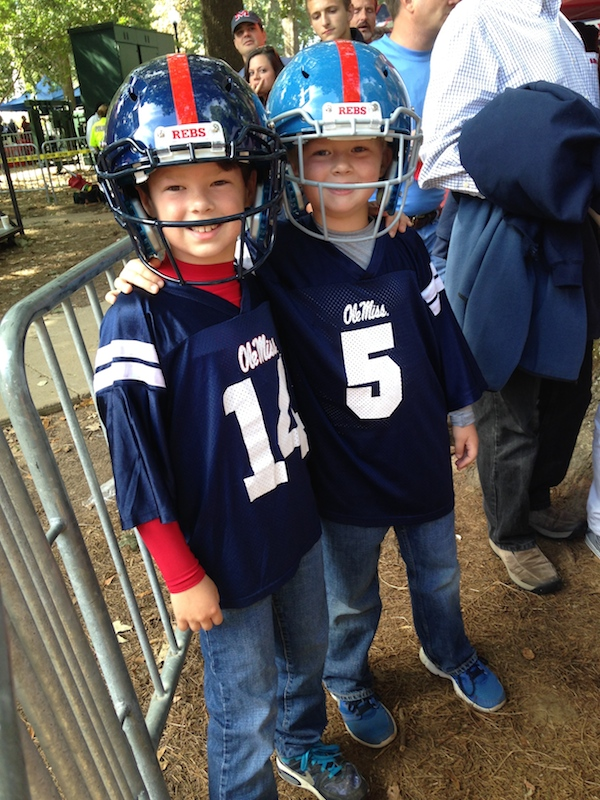 Brothers Huff and West Smith show their Ole Miss support sporting John Currence's Ole Miss helmets