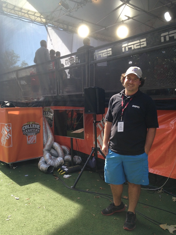 ESPN behind-the-scenes cameraman, Josh Hollingshead, posing in front of the College GameDay set-up