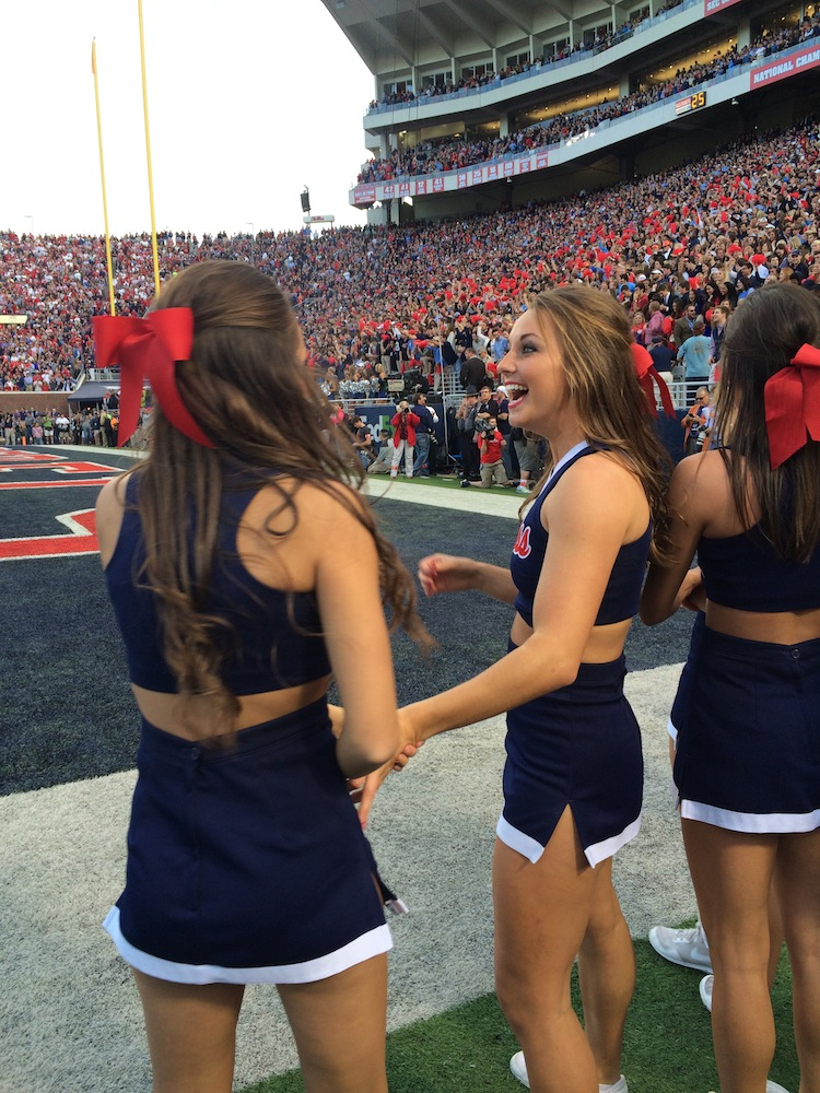 Cheerleaders rushed to the sidelines to watch the final moments of the game. / Photo by Amelia Camurati