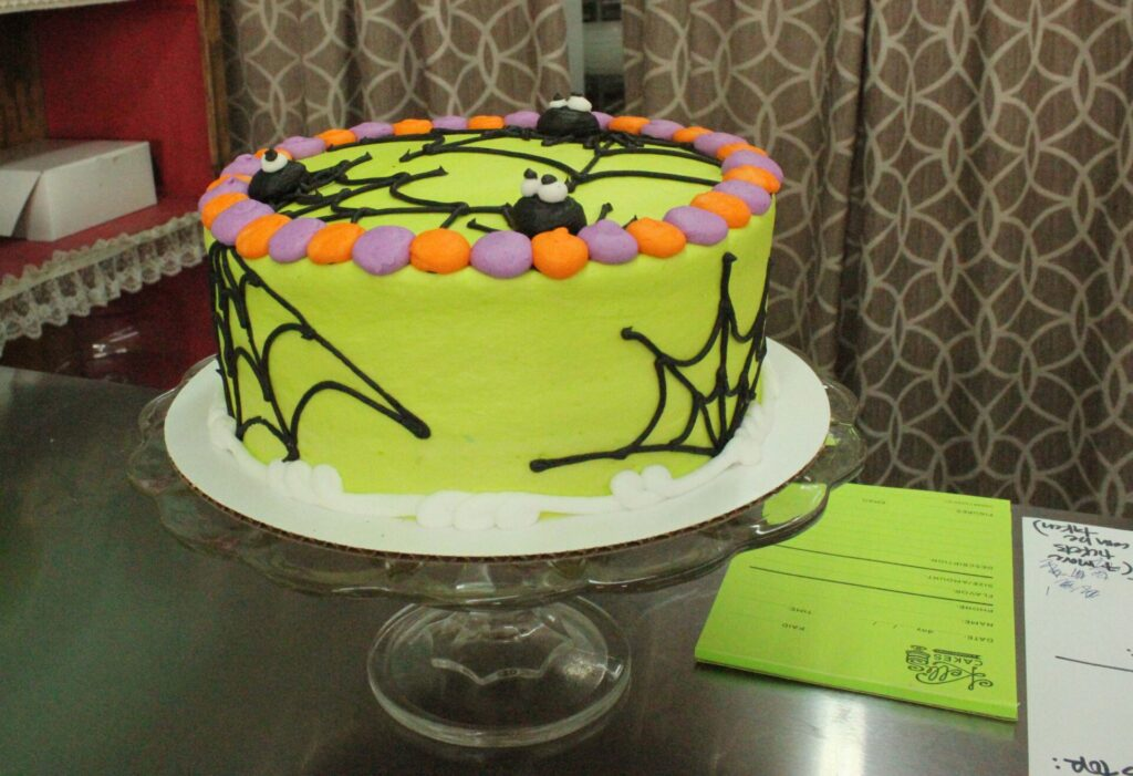 This eye-catching cake is not the only Halloween attraction at Kelli's Bakery. There are ghoulish cookies and pumpkin-dotted cupcakes too.