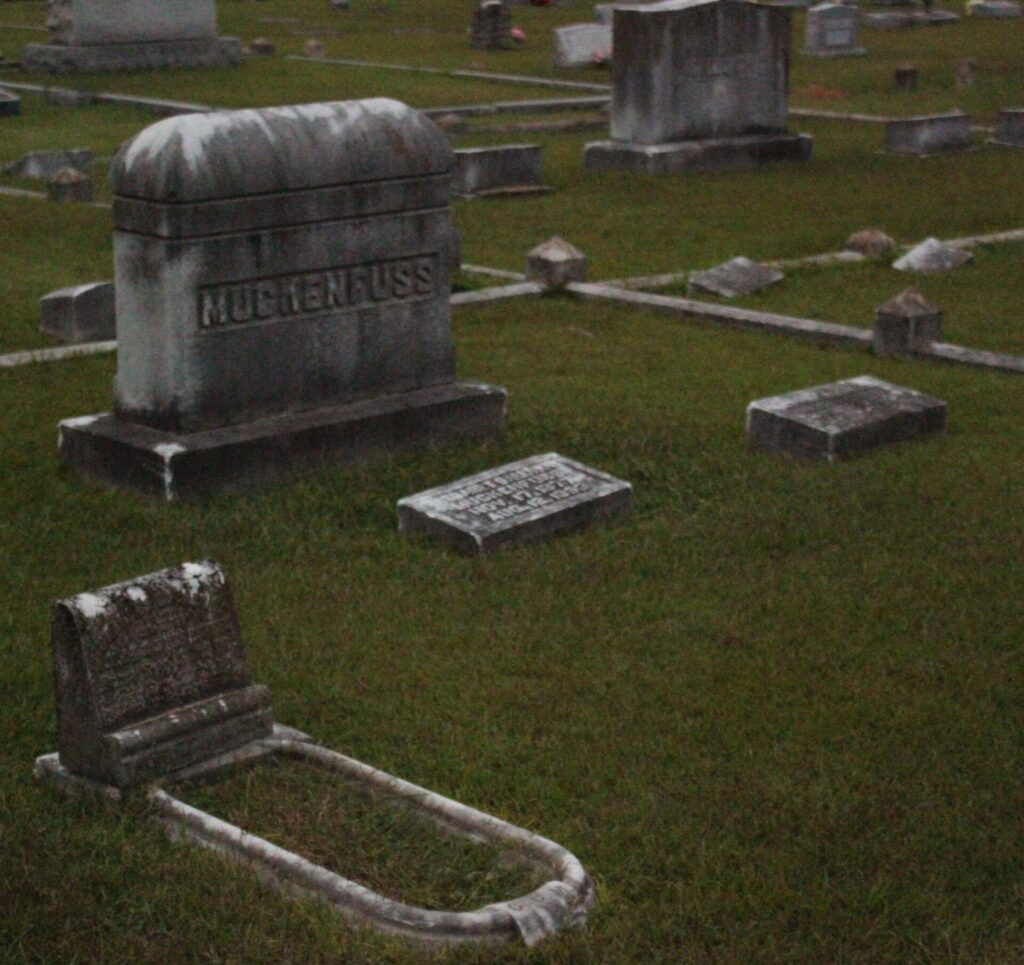 A family of three is buried beneath the Muckenfuss headstone.
