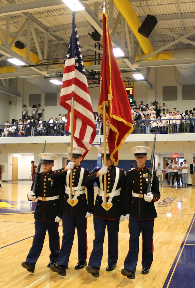 Oxford JROTC students present the colors before tipoff.