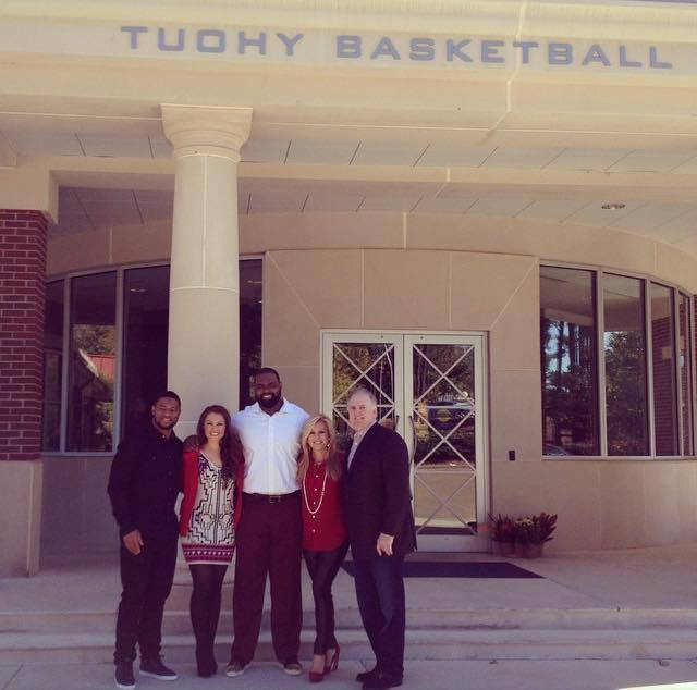 The Touhy Family in front of the basketball center