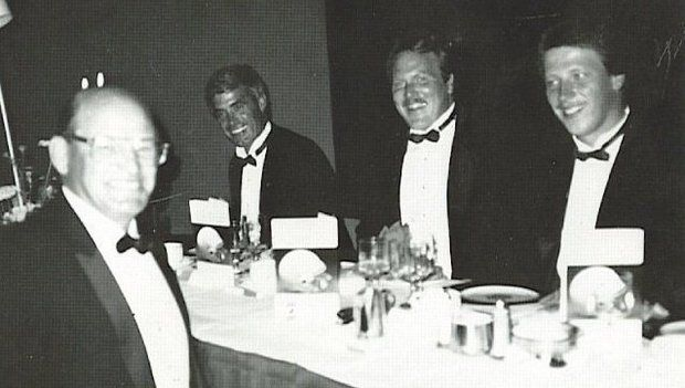 Chuck Commiskey (center) is pictured with former Saints head coach Jim Mora (far left). (photo provided by GulfLive.com)