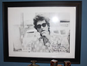 Photo of Bob Dylan backstage in 1965 by Dick Waterman, signed by Dylan