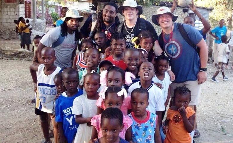 Ole Miss defensive back Ontario Berry, offensive lineman Justin Bell, long snapper Will Few and defensive end John Youngblood (back row, left to right) were among the 17 members of the Ole Miss football family to travel to Camp Marie, Haiti, last spring break.