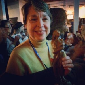 A Mississippi Love Story producer Robbie Fisher with her award for Best Documentary