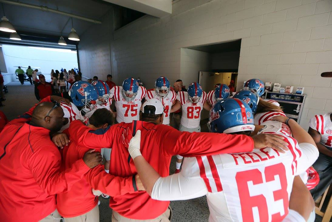 Ole Miss Rebels huddles before the Memphis game, photo by Joshua McCoy, Ole Miss Athletics