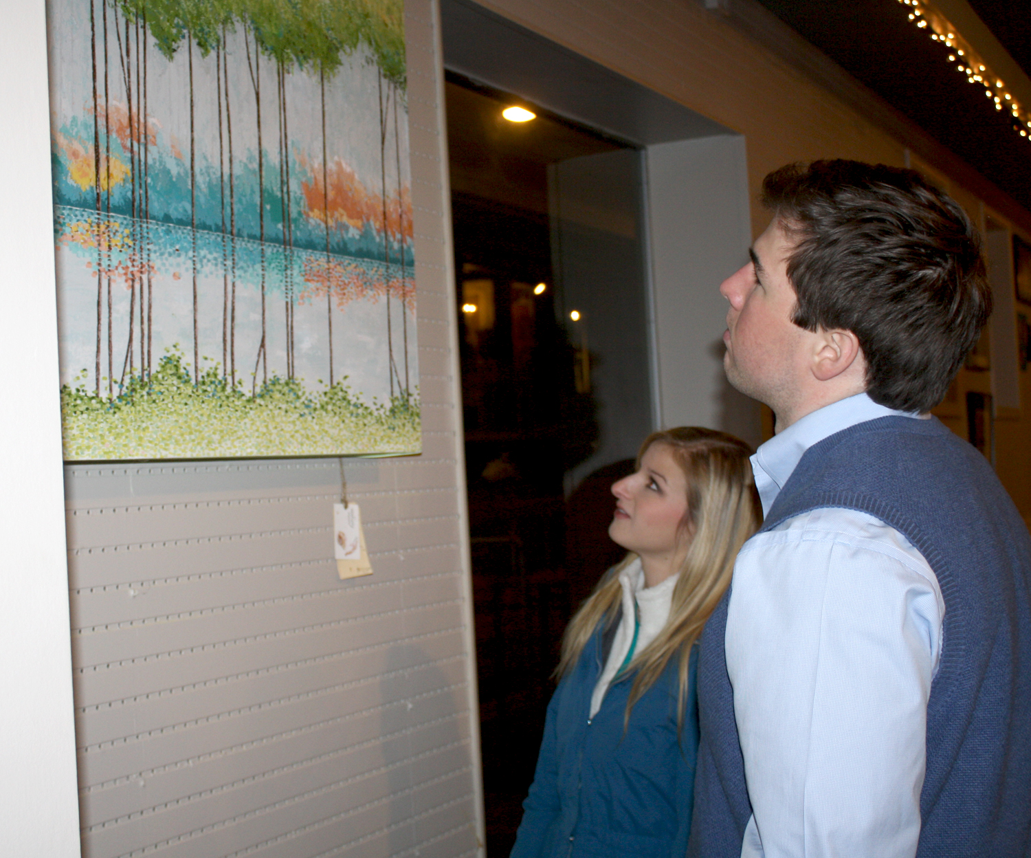 David Kennedy and Kate Rydzak view a painting at the Shelter on Van Buren during the Jan. 26 Oxford Art Crawl. Photo by Jeff McVay