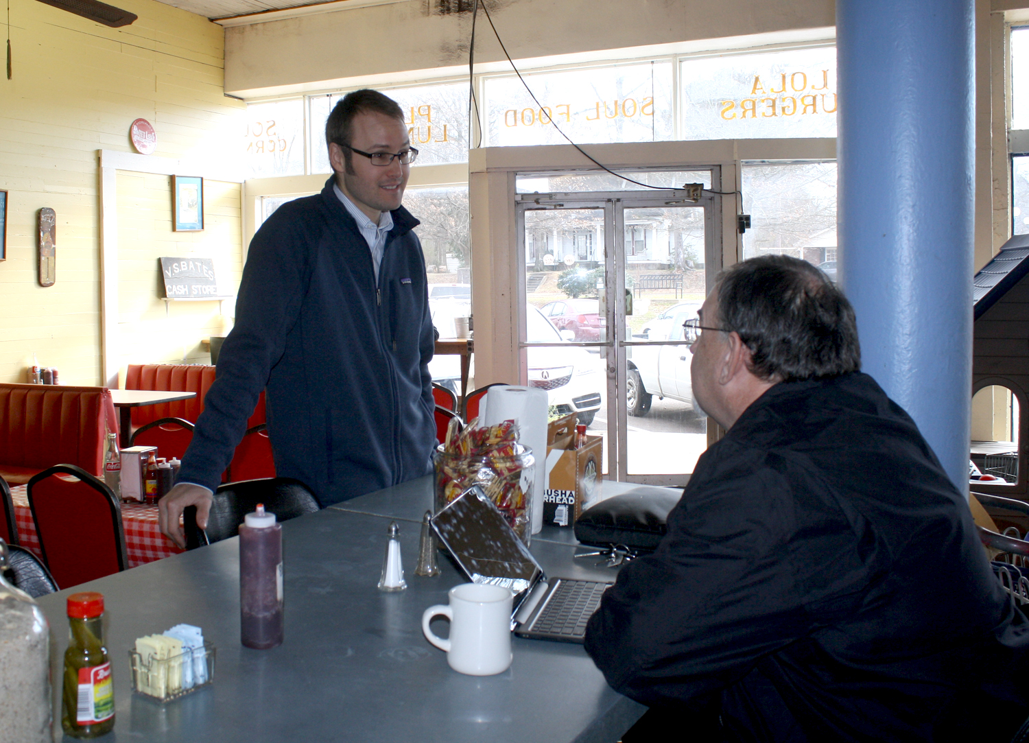 Kagen Coughlin (left) chats with Kevin Guyer at B.T.C. Old Fashioned Grocery on Wednesday, Jan. 26. Photo by Jeff McVay