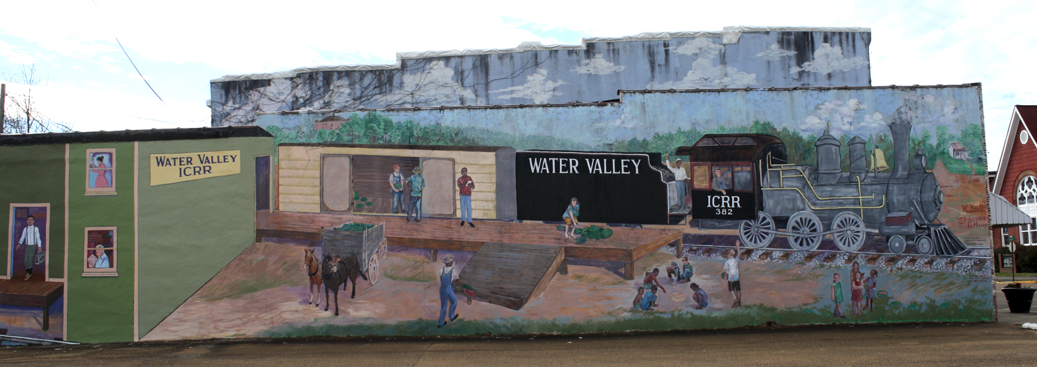 A mural greets residents and guests at the mouth of Main Street in Water Valley, Mississippi. Photo by Jeff McVay