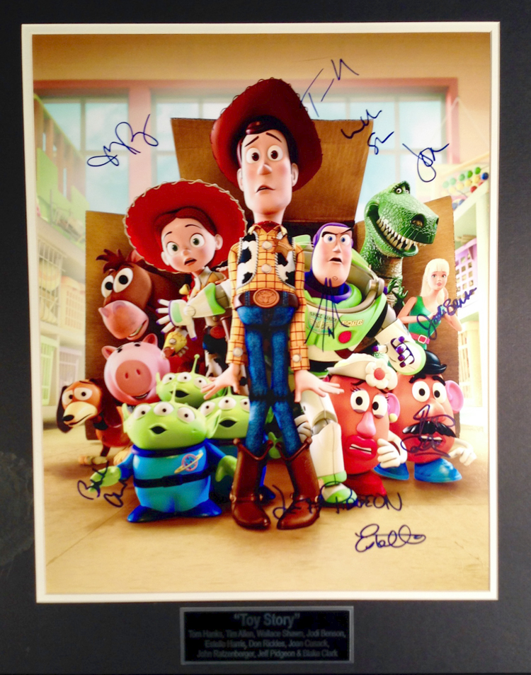 Toy Story Cast autographed - 16X20 animation art