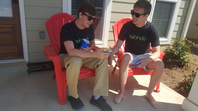 Hobnob representative, Ryan Underwood (pictured left), showing senior Connor Londrigan (pictured right) how the iphone app works.