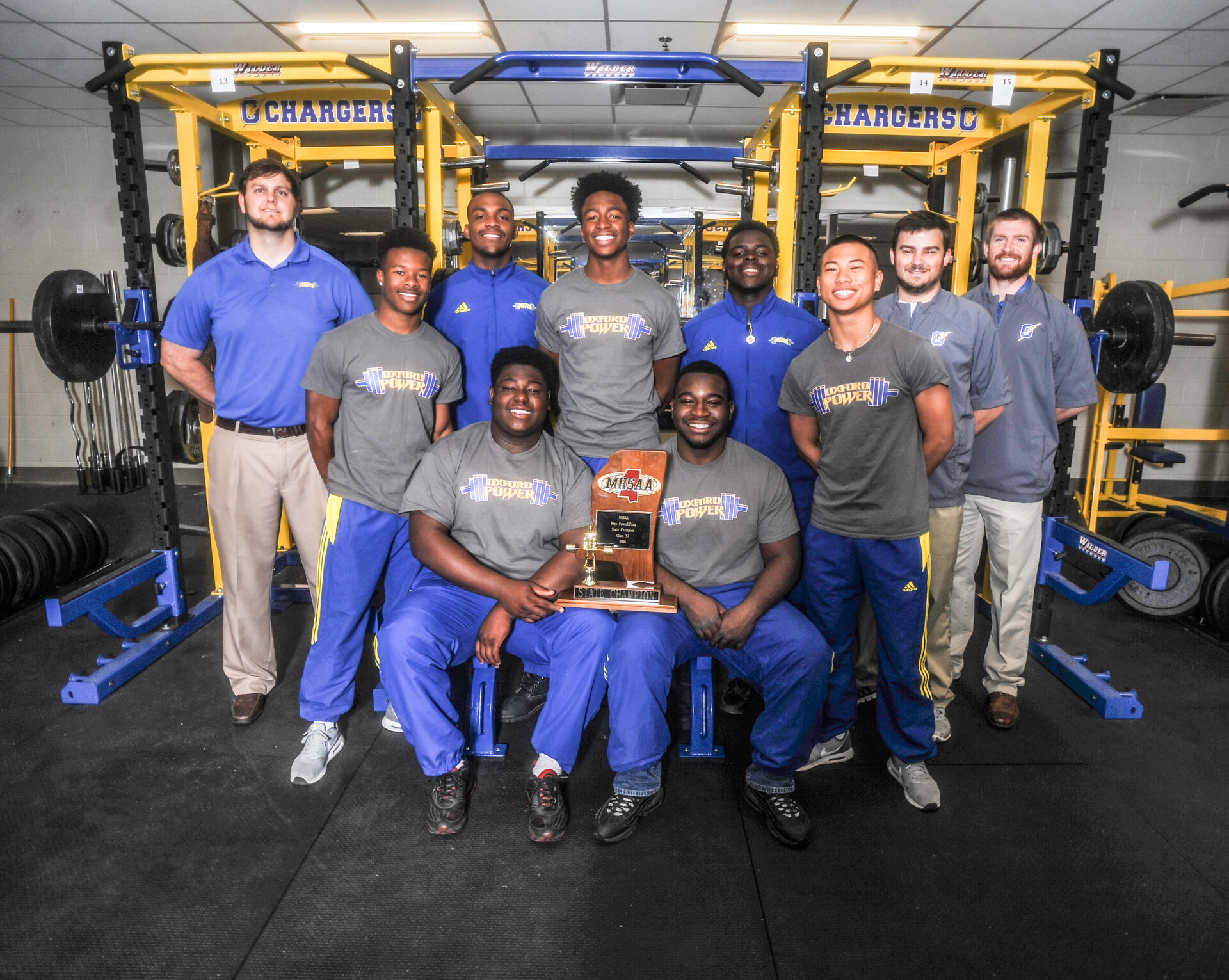 The Oxford High powerlifting team, in Oxford, Miss. on Monday, April 16, 2016, won the school's fourth consecutive powerlifting championship on Saturday, April 16, 2016 in Jackson, Miss. The team is, sitting from left, Jackquez Neilson and Brandon Hill, and standing, from left, coach Jason Russell, Tias Hilliard, Kent Hickinbottom, DQ Thomas, Nick Sisk, Alex Le, and coaches Chris Cutcliffe and Matt McCrory.