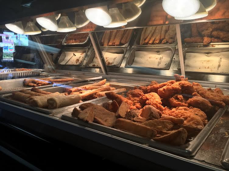 Freshly fried chicken, crispitos, pizza sticks, and potato logs at Chevron's Chicken on a Stick                                      Photo by Shelby Warner