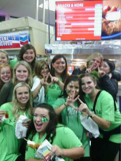 Kappa Delta Sorority celebrating bid day with a chicken on a stick