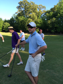 Lynch finds relaxation in the game of golf, seen here with friends on the Ole Miss Golf Course.