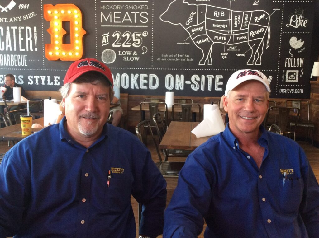 Dickey's Barbecue Pit owners Ray Smith on the left and Jim Rogers on the right. Photo by Liz Foster.