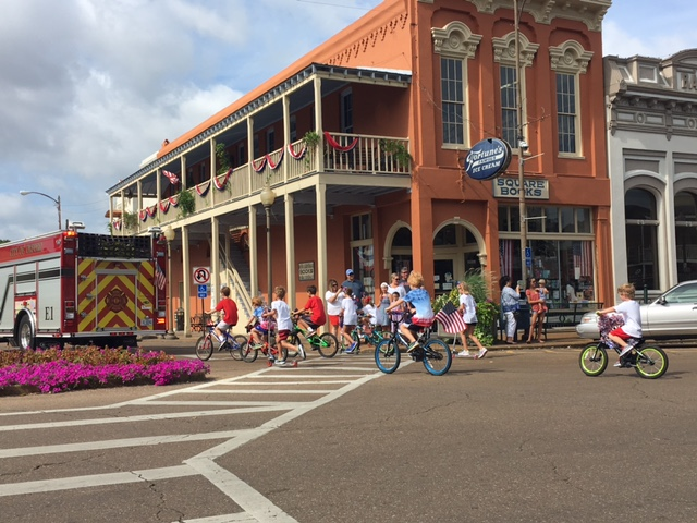 Several children followed the Oxford Firemen at the start of the parade as they went down South Lamar Boulevard.