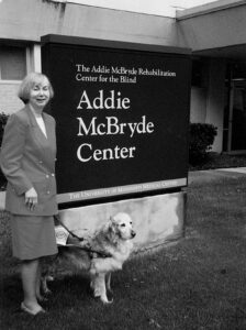 Karen Brown with one of her three guide dogs at Addie McBryde Center.