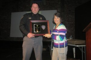 Captain Alan Ivy receiving 2015 Community Service Award presented by Captain Libby Lytle. (Photo from Facebook.com/Oxford Police Department)