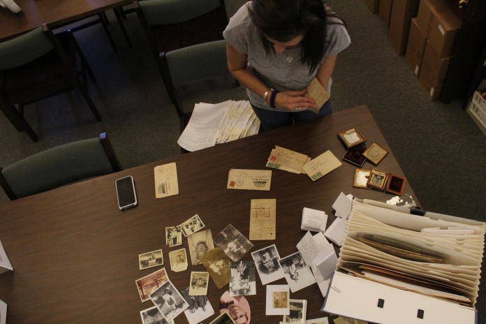 Richardson arranges pictures and letters in the Genealogy Room at the Lafayette County and Oxford Public Library.