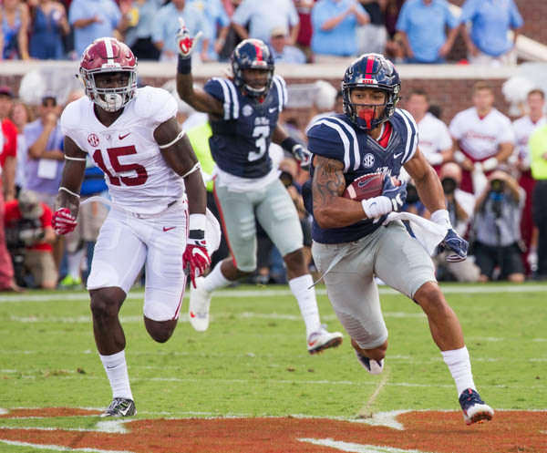 Ole Miss senior Evan Engram snags the reception and beats the tackle from Alabama's Ronnie Harrison at Vaught-Hemmingway stadium Saturday during the Ole Miss v Alabama game.