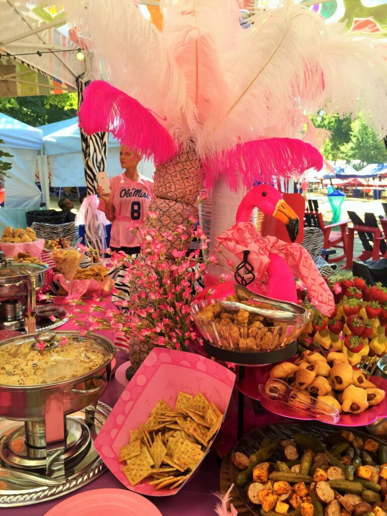Are you ready take a chandelier tour of the grove hottytoddy pink palm tree centerpiece creatively formed with stacked pink pineapples and elaborate fluffy pink and fuschia feathers arubaitofo Image collections