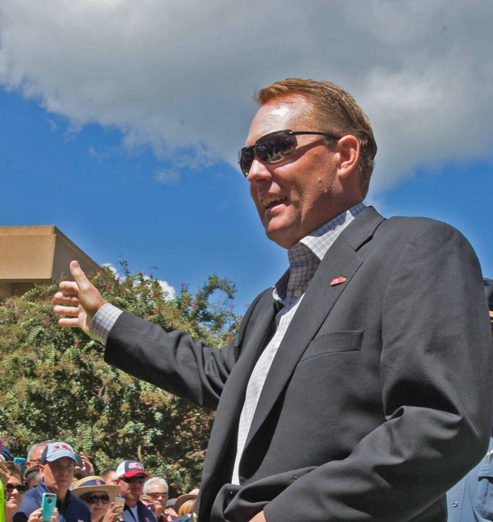 Coach Hugh Freeze steps of the bus as the walk of champions begins in the Grove, Saturday September 12
