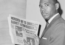 James Meredith holds a newspaper as he attempts to register at the University of Mississippi. Bettmann / Getty Images